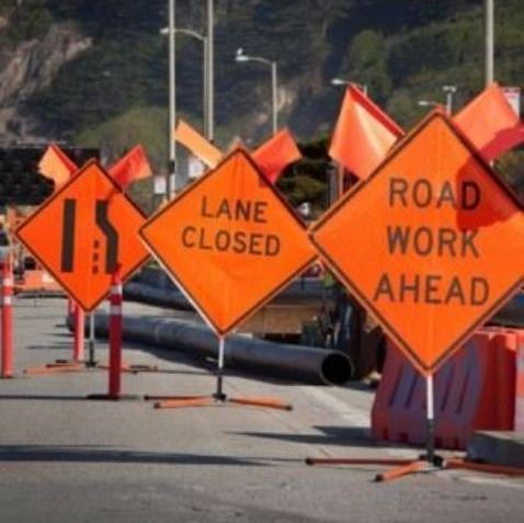 Road Work Ahead and Lane Closure signage on streetfront