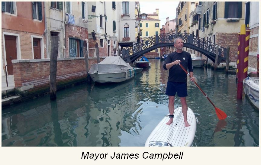 Mayor James Campbell on a Padlleboard