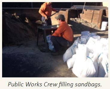 Public Works Crew filling sandbags.