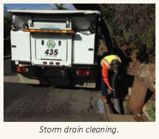 Public Works crew cleaning storm drains.